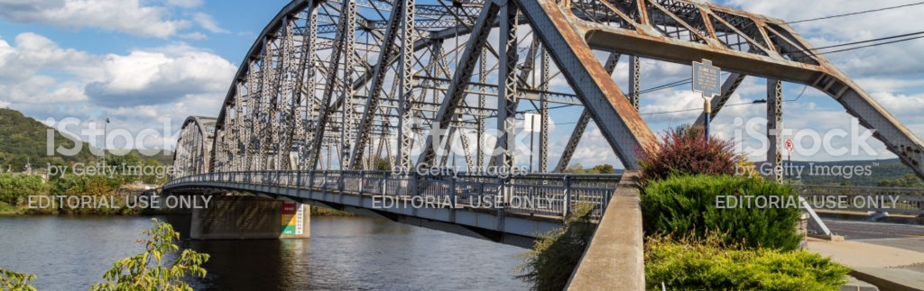 Matamoras, PA, USA - October 17, 2018:  The Mid-Delaware Bridge is a continuous truss bridge which carries U.S. Routes 6 and 209 across the river between the states of New York and Pennsylvania.